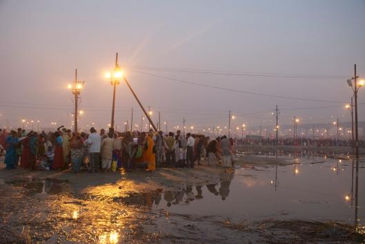 Crowd at dusk kumbh mela india